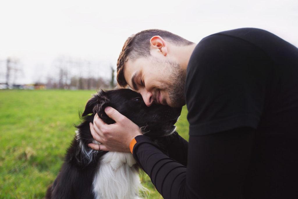 A Pet Sitter Petting a Dog